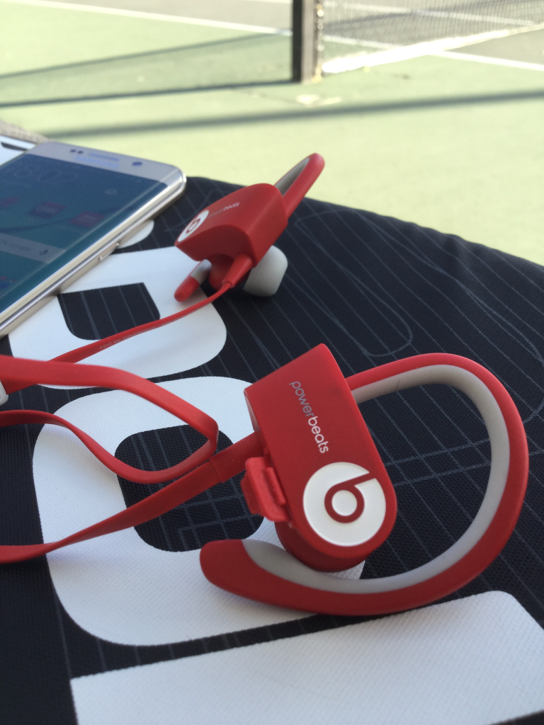 Beats Powerbeats2 Wireless with Samsung Galaxy S6 Edge on Babolat Tennis bag at California High Tennis Court