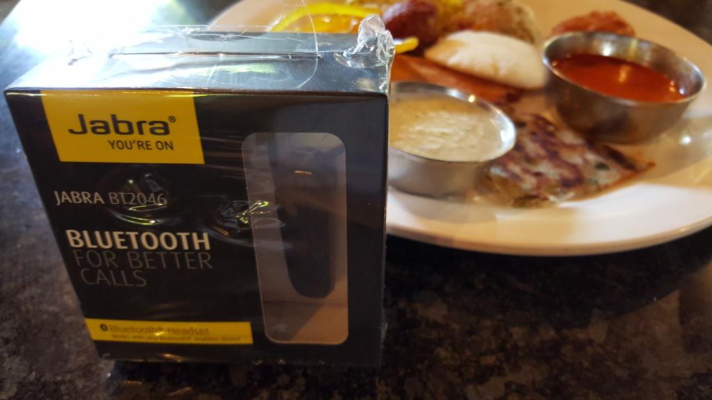 Jabra BT2036 Bluetooth headset box in front of Indian breakfast