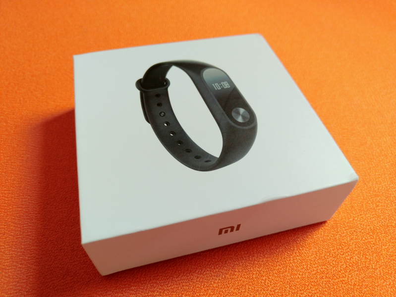 e082fb6f8 Once you open the box, you'll immediately see the Mi Band 2 centerpiece in  the middle of the Box.