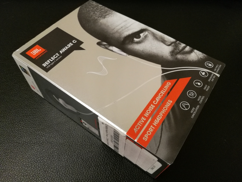 2dd20b89dcb The box that contains the JBL Reflect Aware C headphones looks really hip  in red and gray tones.